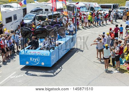 Col du Glandon France - July 23 2015: Krys vehicle during the passing of the Publicity Caravan on Col du Glandon in Alps during the stage 18 of Le Tour de France 2015. Krys is an important chain of optical stores in France. Krys sponsors the White Jersey.