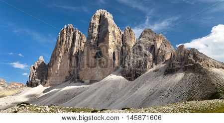 Drei Zinnen or Tre Cime di Lavaredo with green meadow and beautiful sky Sextener Dolomiten or Dolomiti di Sesto South Tirol Dolomiten mountains view Italien Alps