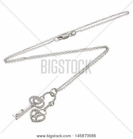 White gold chain with pendant in the shape of a key and lock