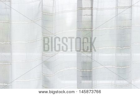 White translucent curtain near the terrace of the bedroom.