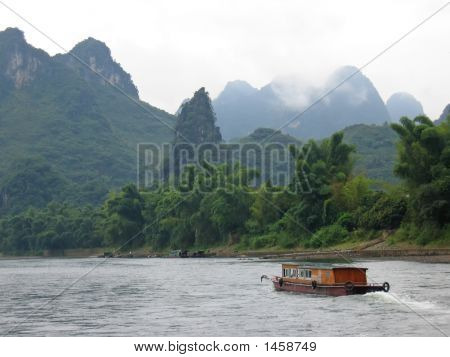 Small Boat On The Li Jiang River, Guilin, China
