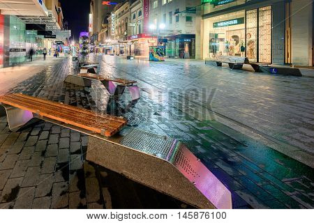 Adelaide Australia - August 11 2015: Adelaide's famous Rundle Mall at night time under the rain during winter season