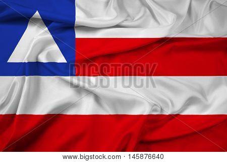 Waving Flag of Bahia State Brazil, with beautiful satin background.
