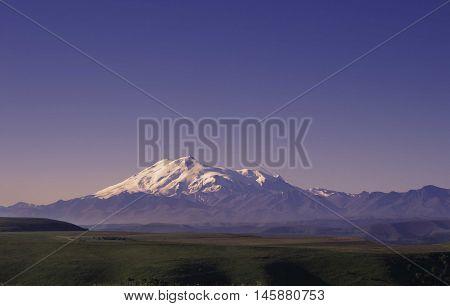 view of snow capped mountains at sunset