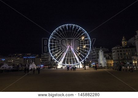 Ferris Wheel By Night At The Old Harbor In Marseille