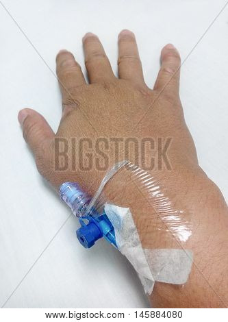 MALACCA, MALAYSIA -MARCH 09, 2016: IV needle is plugged on the left wrist.
