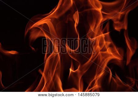 Fire flames in a brick fireplace. Fire flames.