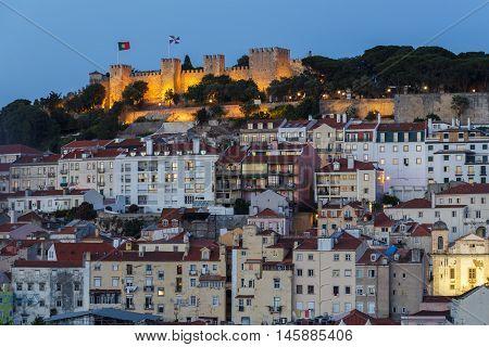 Evening Jorge Castelo de Sao and buildings in Lisbon.