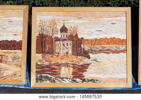 Berdsk Siberia Novosibirsk oblast Russia - September 3 2016: a street exhibition of bark paintings from local artists lovers