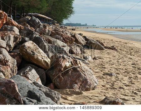 Coast rock dam on the beach to protect from coastal erosion