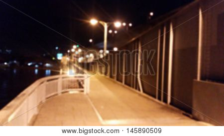 Blurry footpath on the bridge at night background