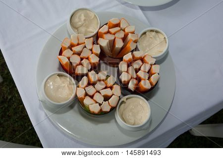 Crab Salad With Fresh Cocktail Sauce On A Plate