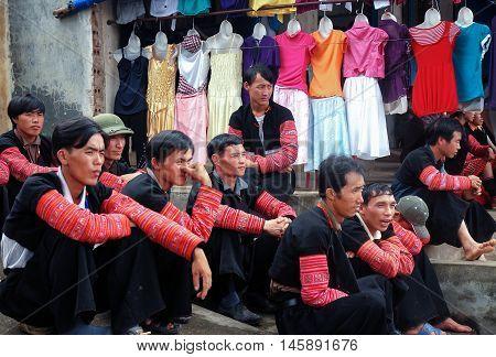 MOC CHAU, VIETNAM, August 28, 2016 the group of men, ethnic Hmong, highland Moc Chau, Son La, Vietnam, rest, next, clothing stores