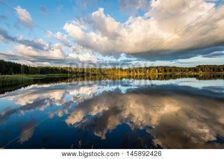 Beautiful Summer Sunset At The Lake With Blue Sky, Red And Orange Clouds