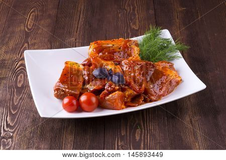 Pieces Of Raw Pork On White Plate. Chunks Of Barbecue In A Sauce. Pieces Of Raw Pork In Barbecue Sau