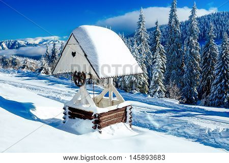 beautiful romantic old style well with wooden roof and heart shape ornament
