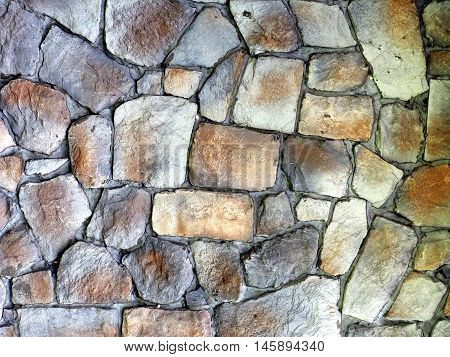 Round stone wall or pavement using for background or pattern.