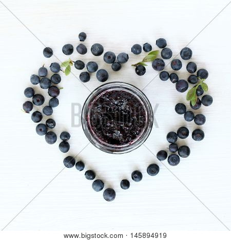 flat layout with blueberry heart berry berry jam the jar around top view / sweet favorite jam from forest berries