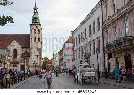KRAKOW, POLAND - SEP 4, 2016: One of the streets in historical center of city. In 2000, Krakow was named European Capital of Culture, the city hosted the World Youth Day in July 2016.