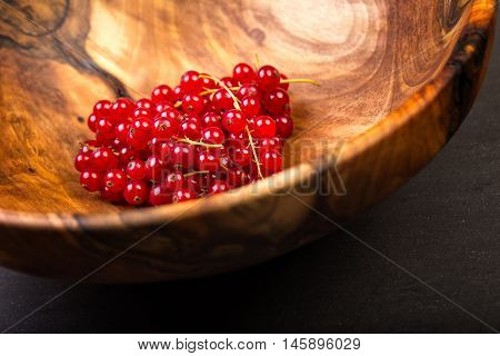 Bunch Of Red Currants In A Bowl From Walnut Wood