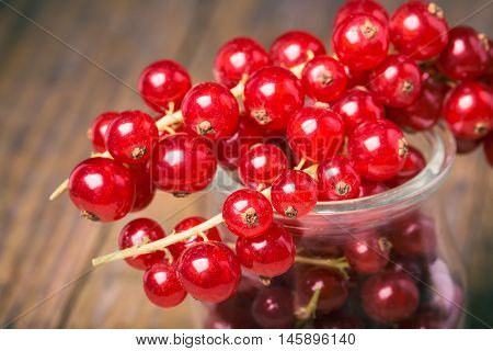 Bunch Of Red Currants In A Glass Cup.