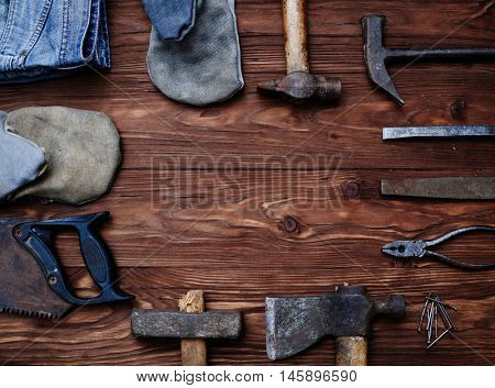 Working hand tools carpenter forming a frame isolated on grunge wooden background