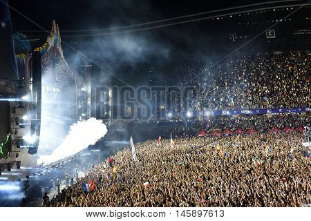 Smoke Cannons Emitting Smoke On Crowd At A Concert