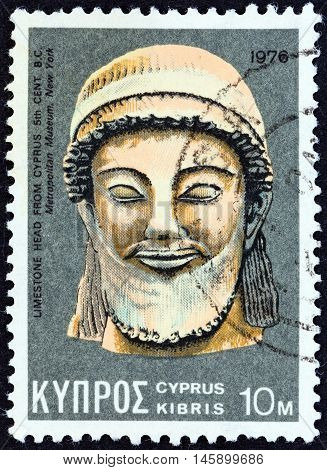 CYPRUS - CIRCA 1976: A stamp printed in Cyprus shows a limestone head from 5th century BC found in Cyprus and now exposed in in Metropolitan museum New York, circa 1976.