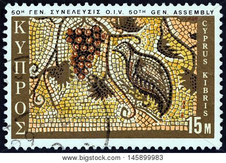 CYPRUS - CIRCA 1970: A stamp printed in Cyprus issued for the 50th General Assembly of International Vine and Wine Office shows Grapes and Partridge mosaic, Paphos, circa 1970.