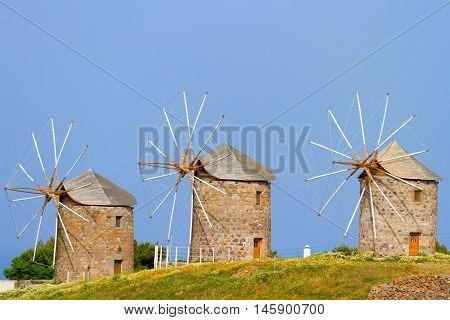 Three windmills in Patmos Greece. Horizontal shot