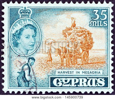 CYPRUS - CIRCA 1955: A stamp printed in Cyprus shows harvest in Mesaoria and Queen Elizabeth II, circa 1955.