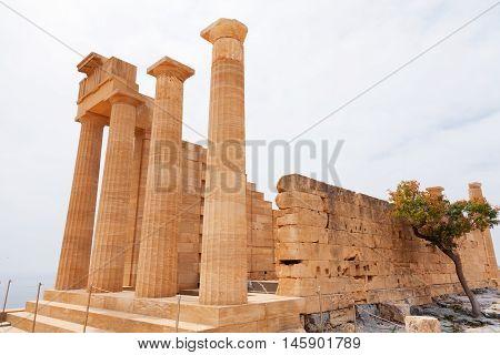 Ancient columns on Lindos Rhodes island Greece. Vertical shot