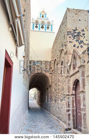 Famous church in Fira Santorini over a narrow street