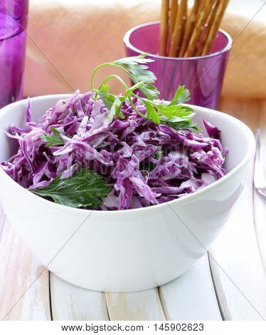 Traditional coleslaw (fresh cabbage salad) on a wooden table