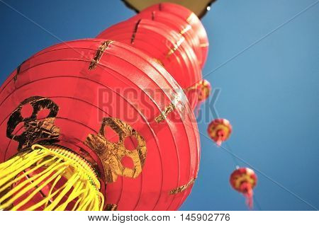 Red Chinese lanterns focus on the foreground