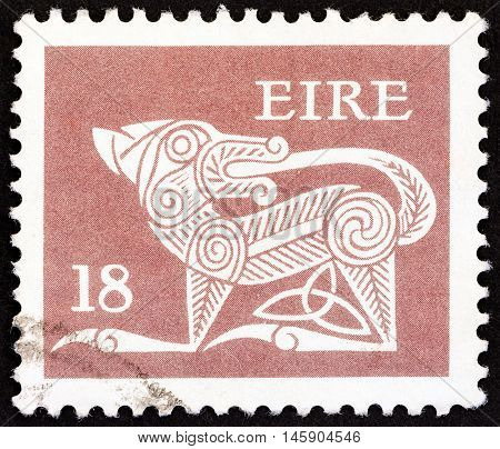 IRELAND - CIRCA 1981: A stamp printed in Ireland shows a dog from an ancient artwork, circa 1981.