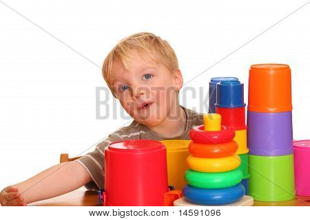 Young Boy With Toy Pyramid