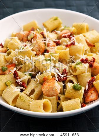 Italian Rigatoni with salmon and dried tomatoes. Vertical shot