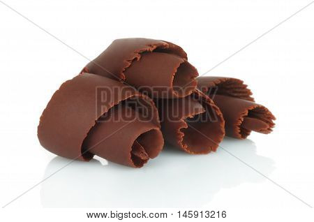 Chocolate shavings on a white background close-up