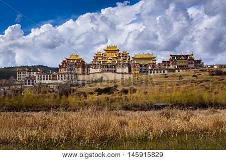 View of Songzanlin temple with clouds background in Shangri-la, China