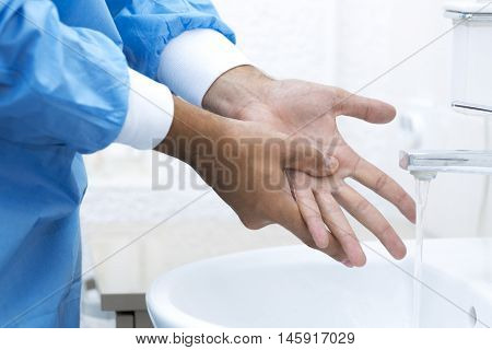 surgeon washing hands before surgery in sink