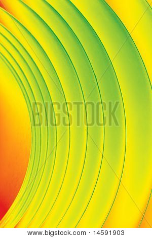 Background Macro Image Of A Pattern Made Of Curved Sheets Of Paper In Yellow, Orange And Green Colou