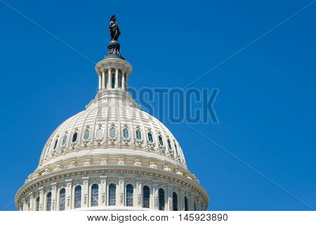 The dome of the US Capitol at Washington D.C. on a blue sky background