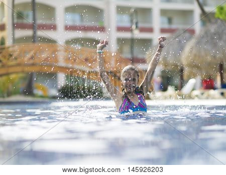 Happy Girl In The Swimming Pool