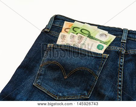 In the back pocket of blue jeans pants are banknotes in denominations hundred and fifty euro notes and three thousand Russian rubles