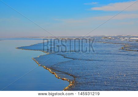 Pacific coast ocean waves and shoreline. Scenic destination of natural beach coast. Pacific Northwest vacation destination.