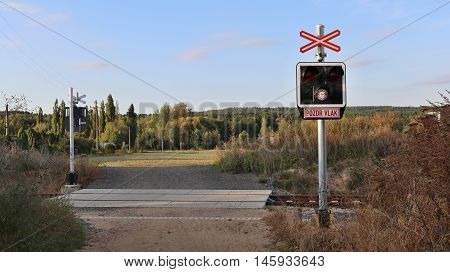 Railroad crossing signaling in the midst of nature