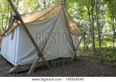 Luxury Camping Tent in the Woods on a Sunny Day