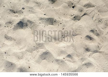 Footprints in the sand. Texture of sand and footprints in the sand