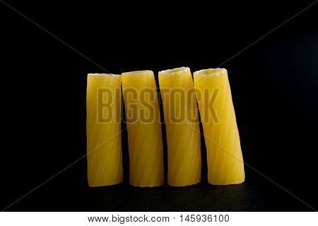 Rigatoni. Pasta on black background,  close up